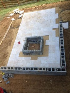 travertine patio and firepit construction